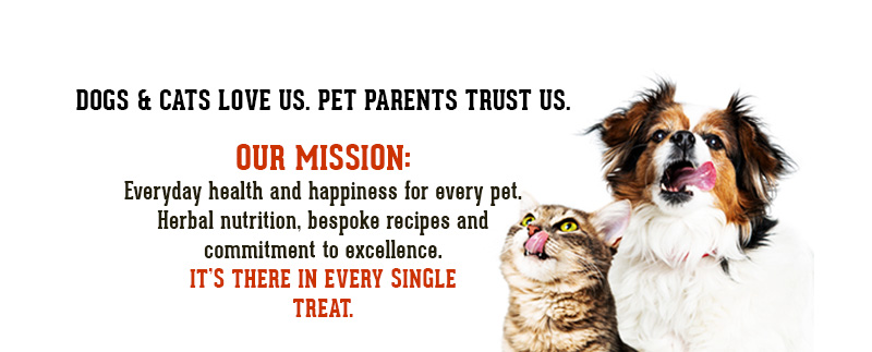 A cute dog and cat are licking their lips.  Words say: Dogs & Cats love us. Pet Parents trust us. Our mission: Everyday health and happiness for every pet. Herbal nutrition, bespoke recipes & commitment to excellence make it happen. It's there in every single treat.